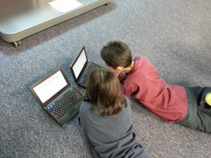 children using laptop computers